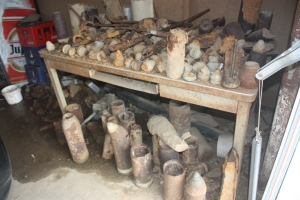 Bomb fragments and unexploded First World War shells sit in a farmer's shed waiting for pickup.