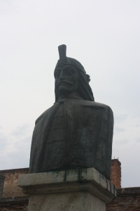A bust of Vlad the Impaler, the model more or less for Bram Stoker's Dracula is on a pedestal outside the remains of his 15th century residence.