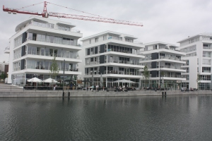 Ground floor restaurants with offices and housing above.